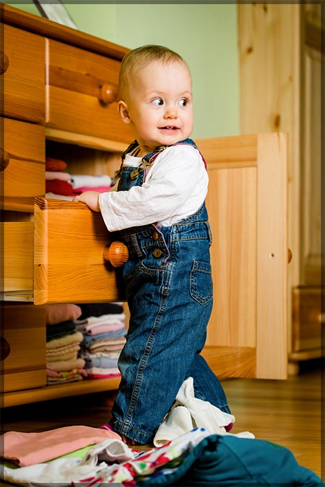 Baby opening drawers