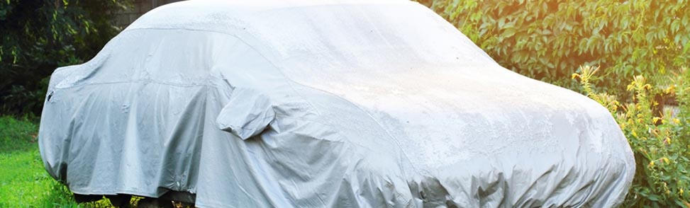 A car stored under a tarp